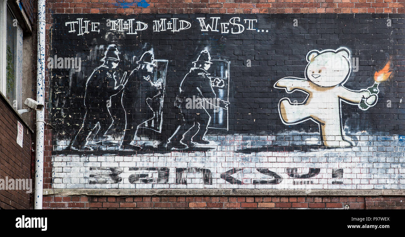 Famous Banksy piece  Mild Mild West on a brick wall in the Bristol city center - Stock Image