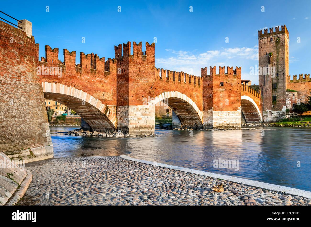 Verona, Italy. Scenery with Adige River and Ponte Scaligero and Castelvecchio, medieval landmarks of veronese city. - Stock Image