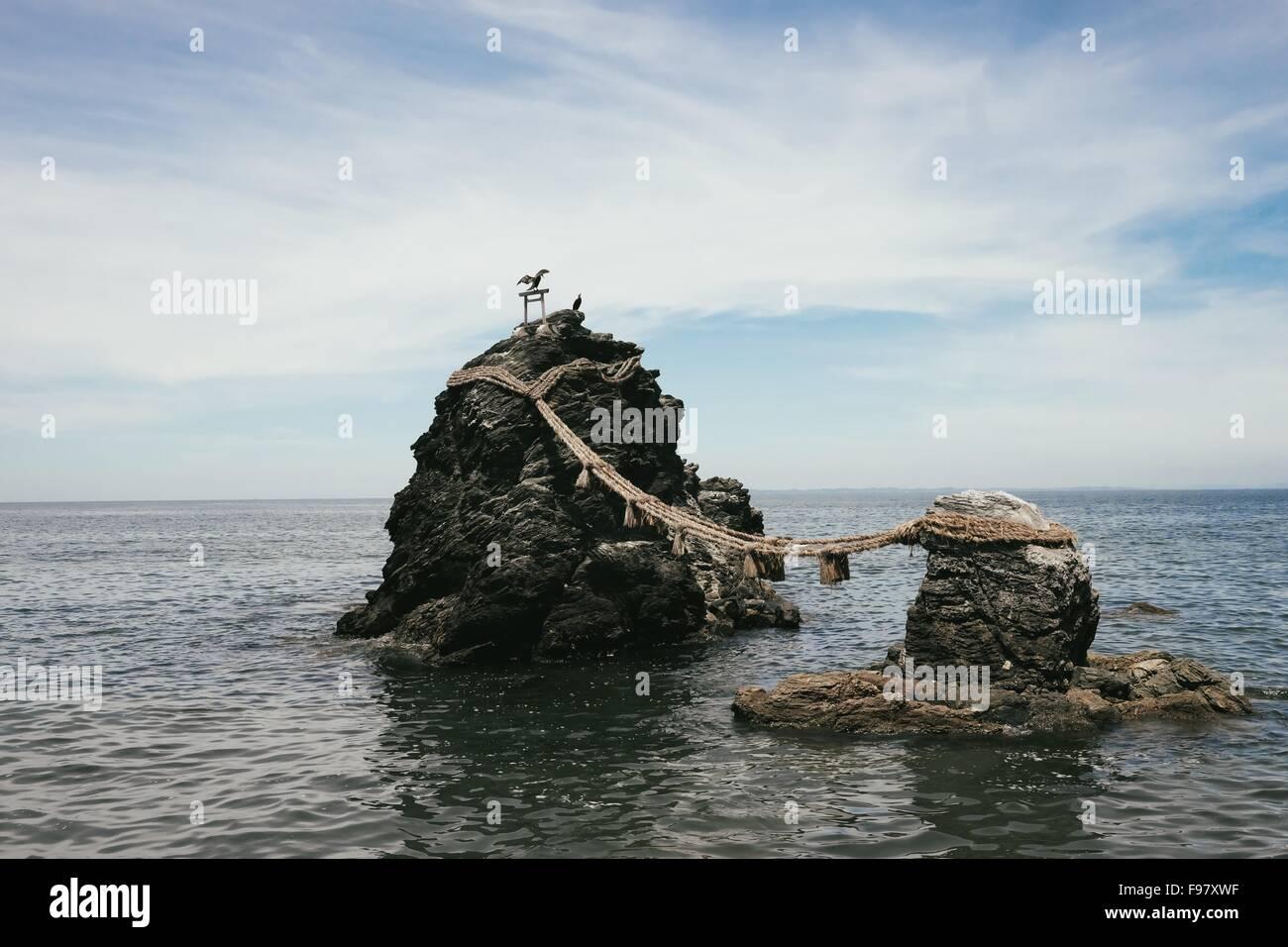 Meoto Iwa Against Cloudy Sky - Stock Image