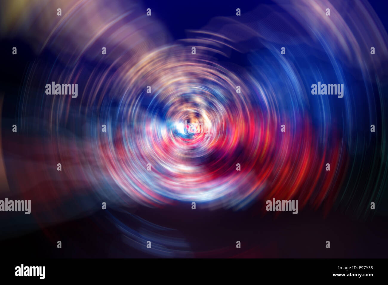 Spinning Neon LED Abstract lights form a centrally moving blur, radiating from a central core. - Stock Image
