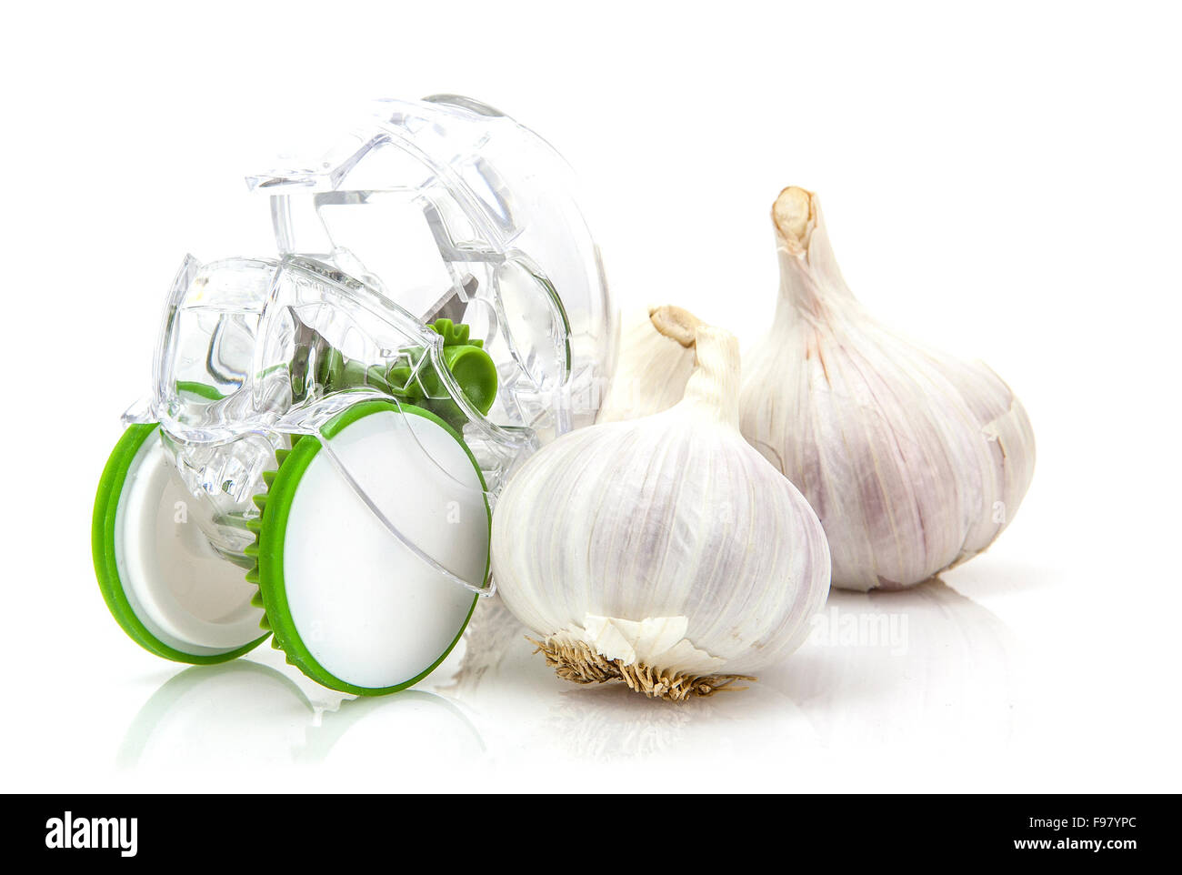 Garlic Cloves with cutter on white background - Stock Image