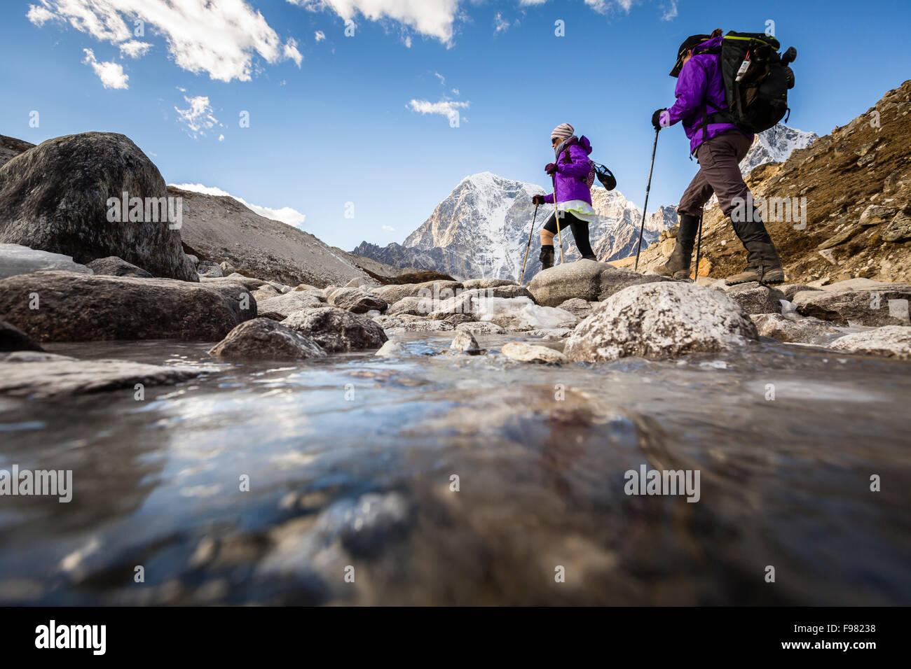 Two women are hiking a trail, Sagarmatha National Park, Khumbu region, Nepal. - Stock Image