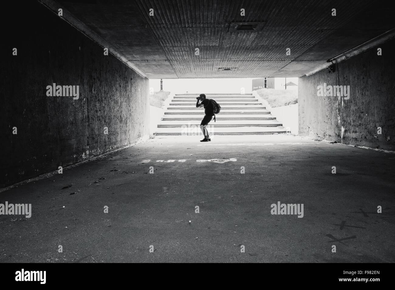 Side View Of Man Photographing In Tunnel - Stock Image