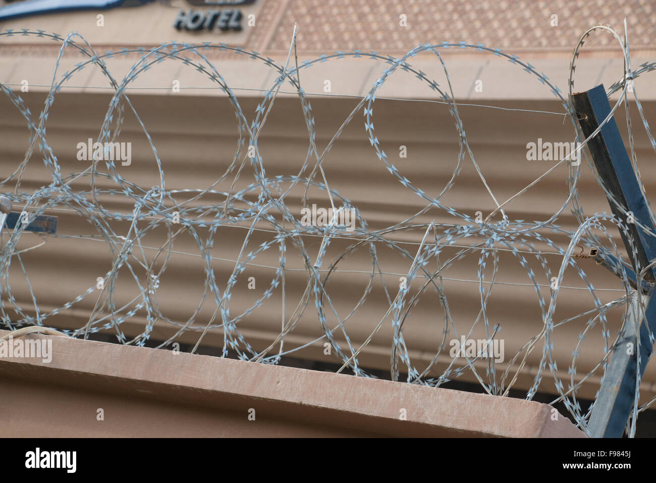 Barbwire securing hotel in Xinjiang China - Stock Image