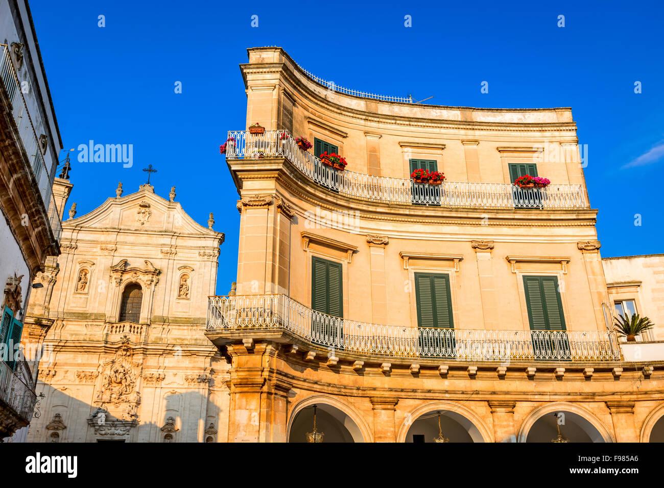 Martina Franca, Puglia in Italy. Piazza Plebiscito and Basilica di San Martino, landmark of Brindisi region in Apulia, - Stock Image
