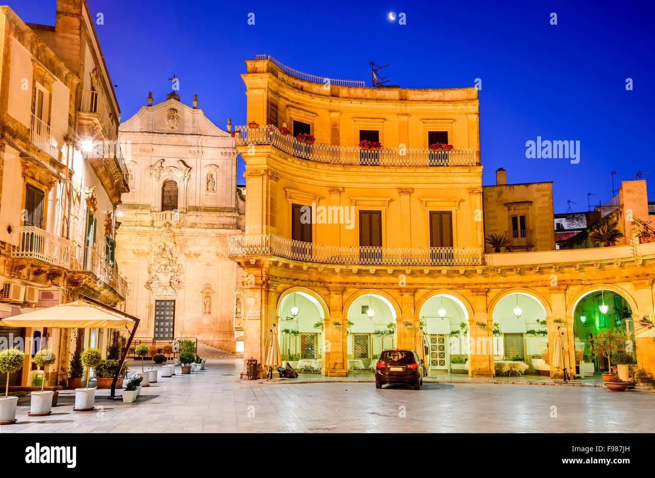 Martina Franca, Puglia in Italy. Piazza Plebiscito and Basilica di San Martino at twilight. - Stock Image