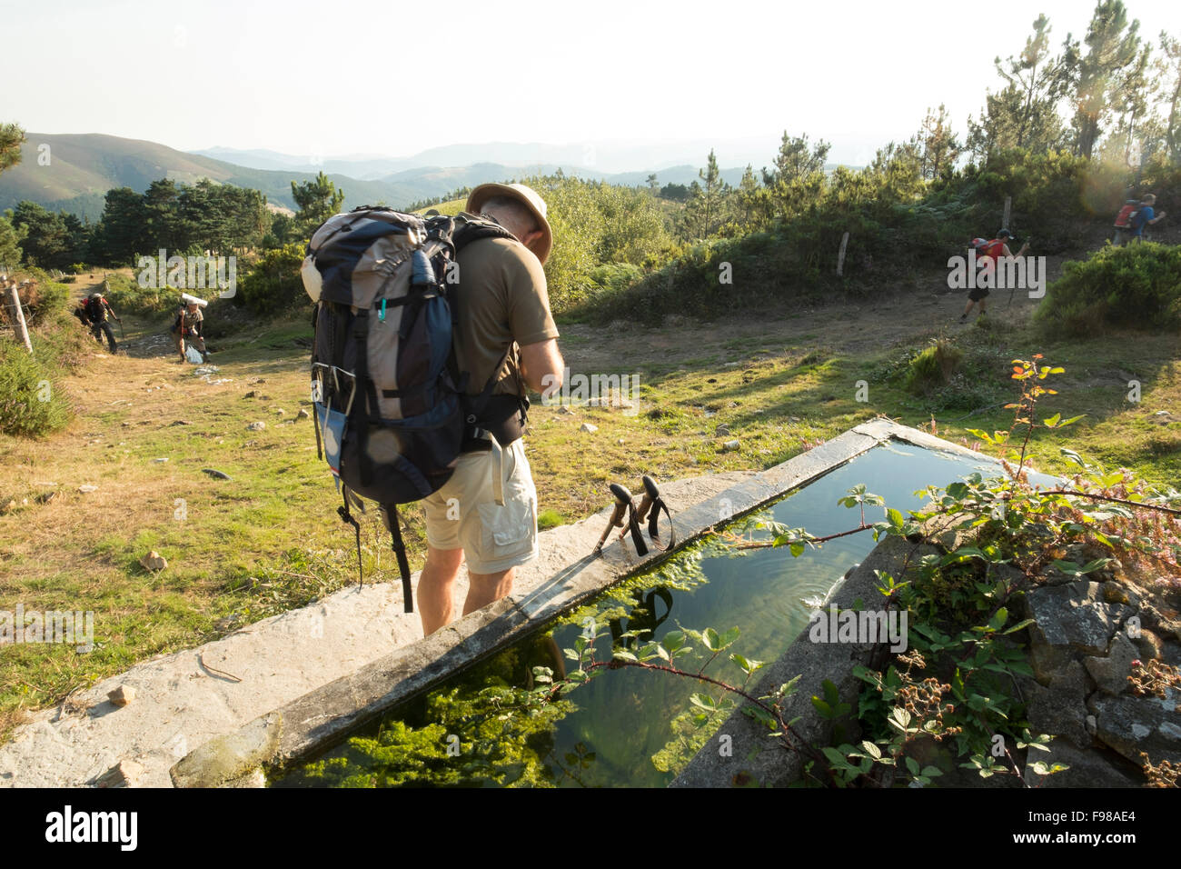 A spring along the Camino Primitivo is frequented by pilgrims in the northern mountains of Spain. - Stock Image