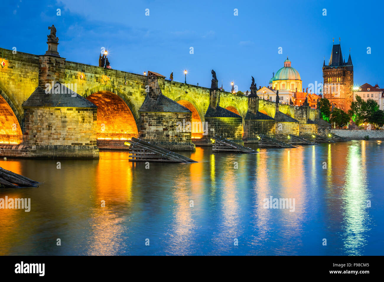 Prague, Czech Republic. Charles Bridge and Mala Strana towers, with Prague Castle (Hrad) in background twilight - Stock Image