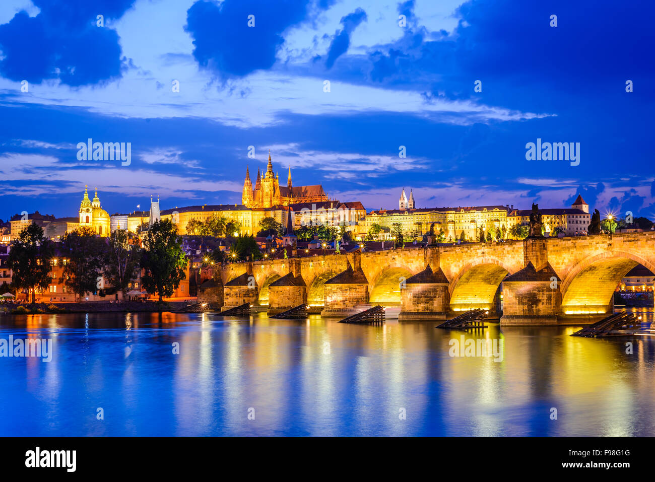 Prague, Czech Republic. Charles Bridge and Hradcany (Prague Castle) with St. Vitus Cathedral and St. George church - Stock Image