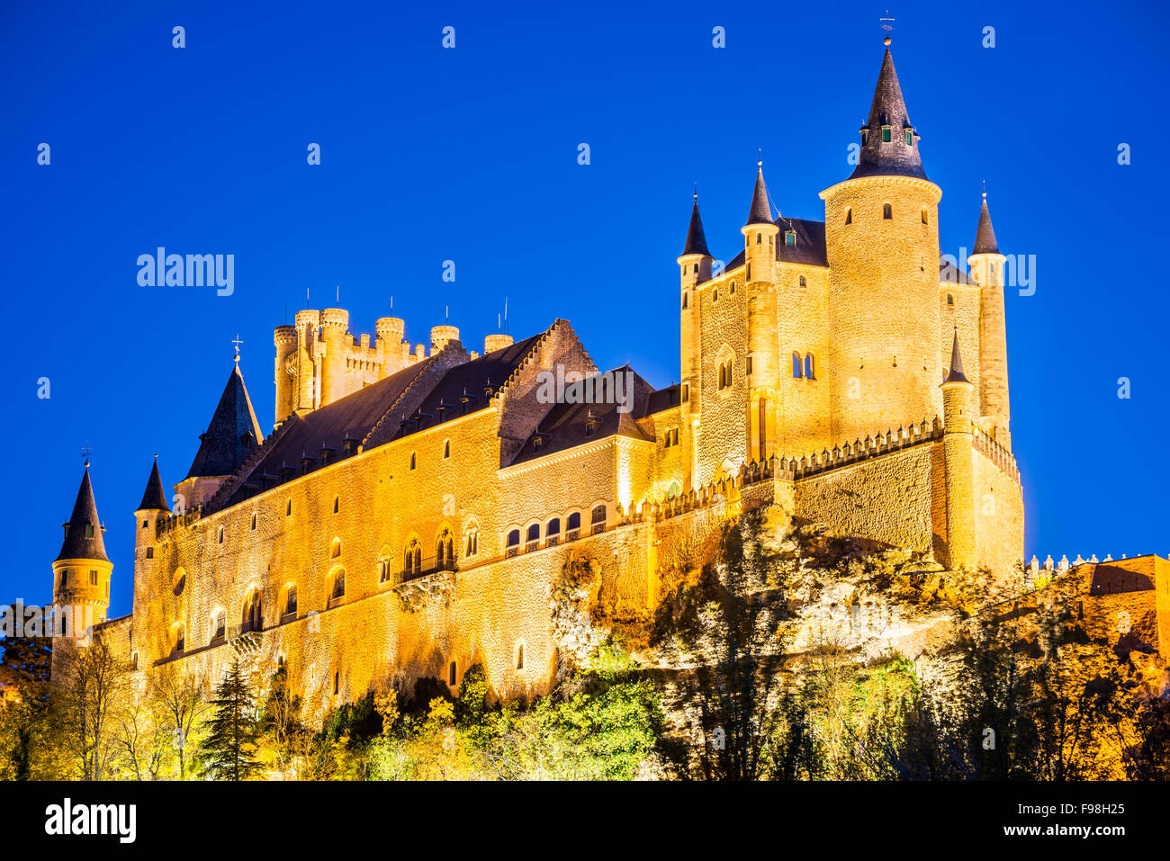 Segovia, Spain. Autumn dusk view of Castle of Segovia, known as Alcazar and built in 12th century in Castile and - Stock Image