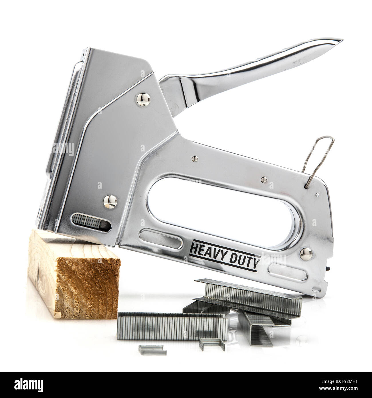 Heavy duty staple gun with staples isolated on white - Stock Image