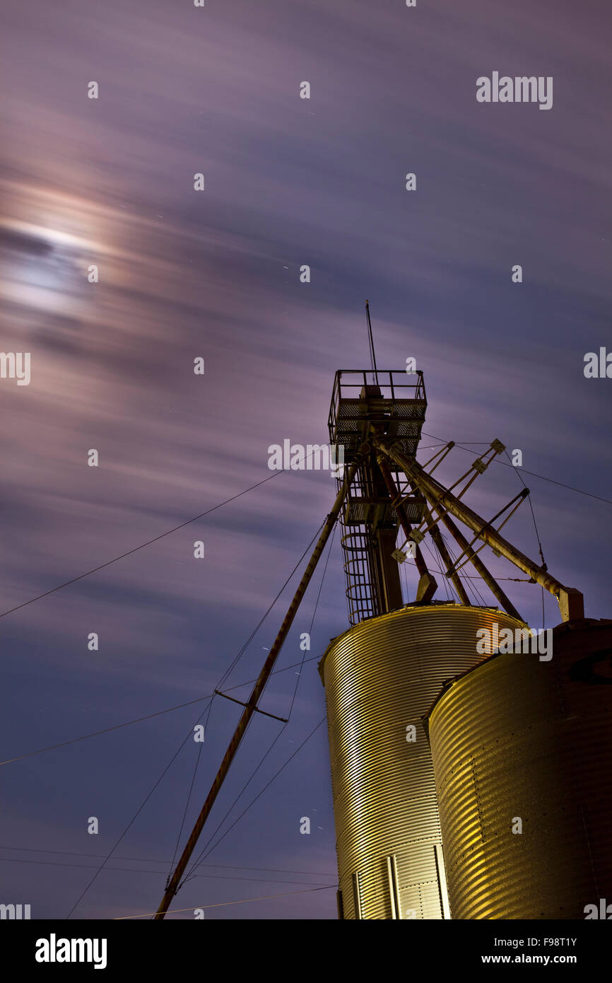 Grain mill by night sky. - Stock Image