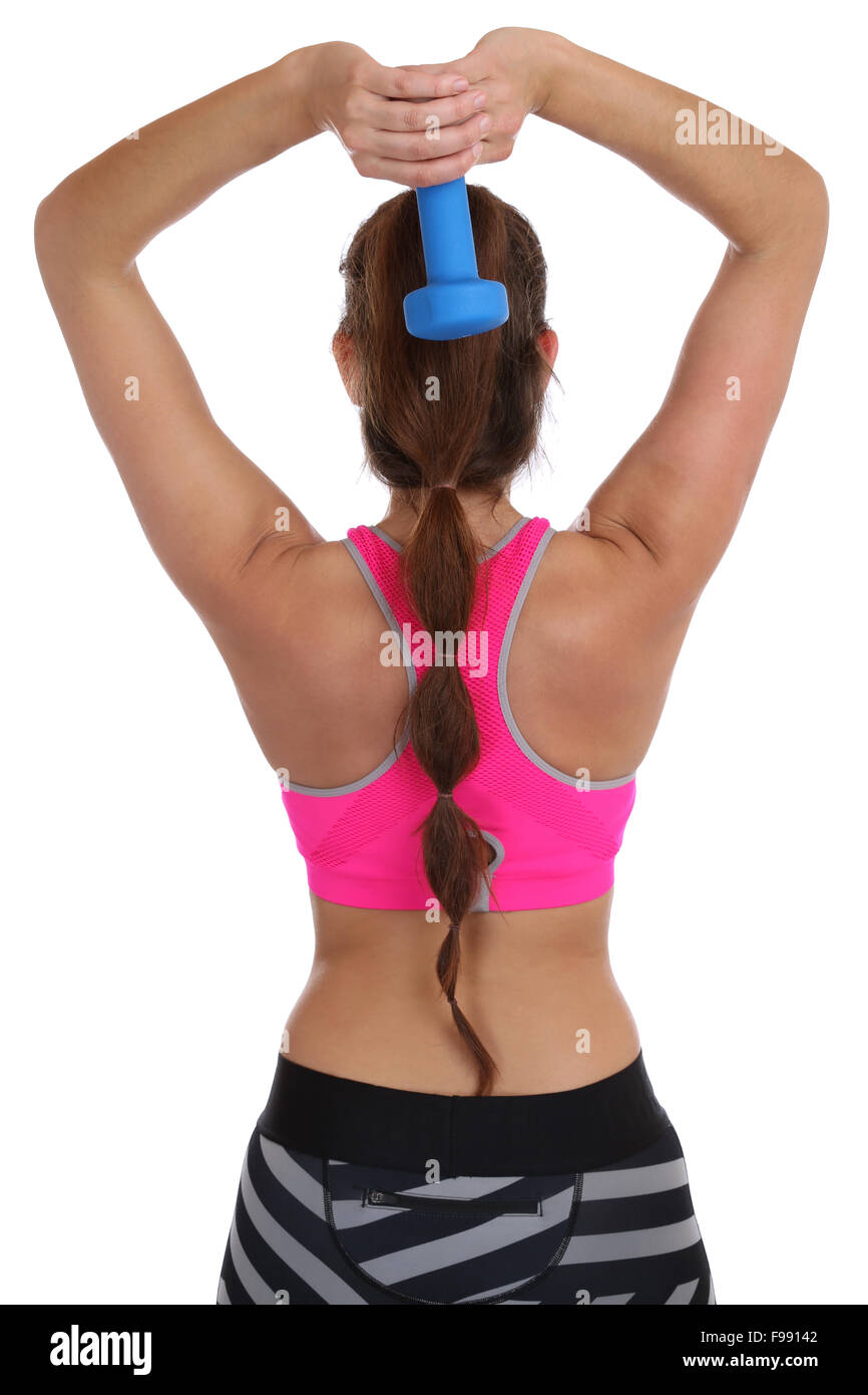 Fitness woman at sports workout training back shoulder triceps with dumbbell isolated on a white background - Stock Image