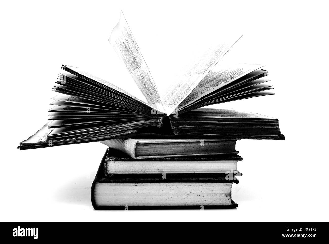 Pile of old books on a white background - Stock Image