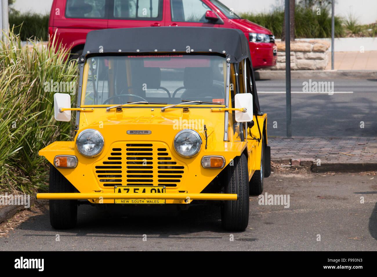 yellow Mini Moke motor car vehicle parked in North Sydney,Australia - Stock Image