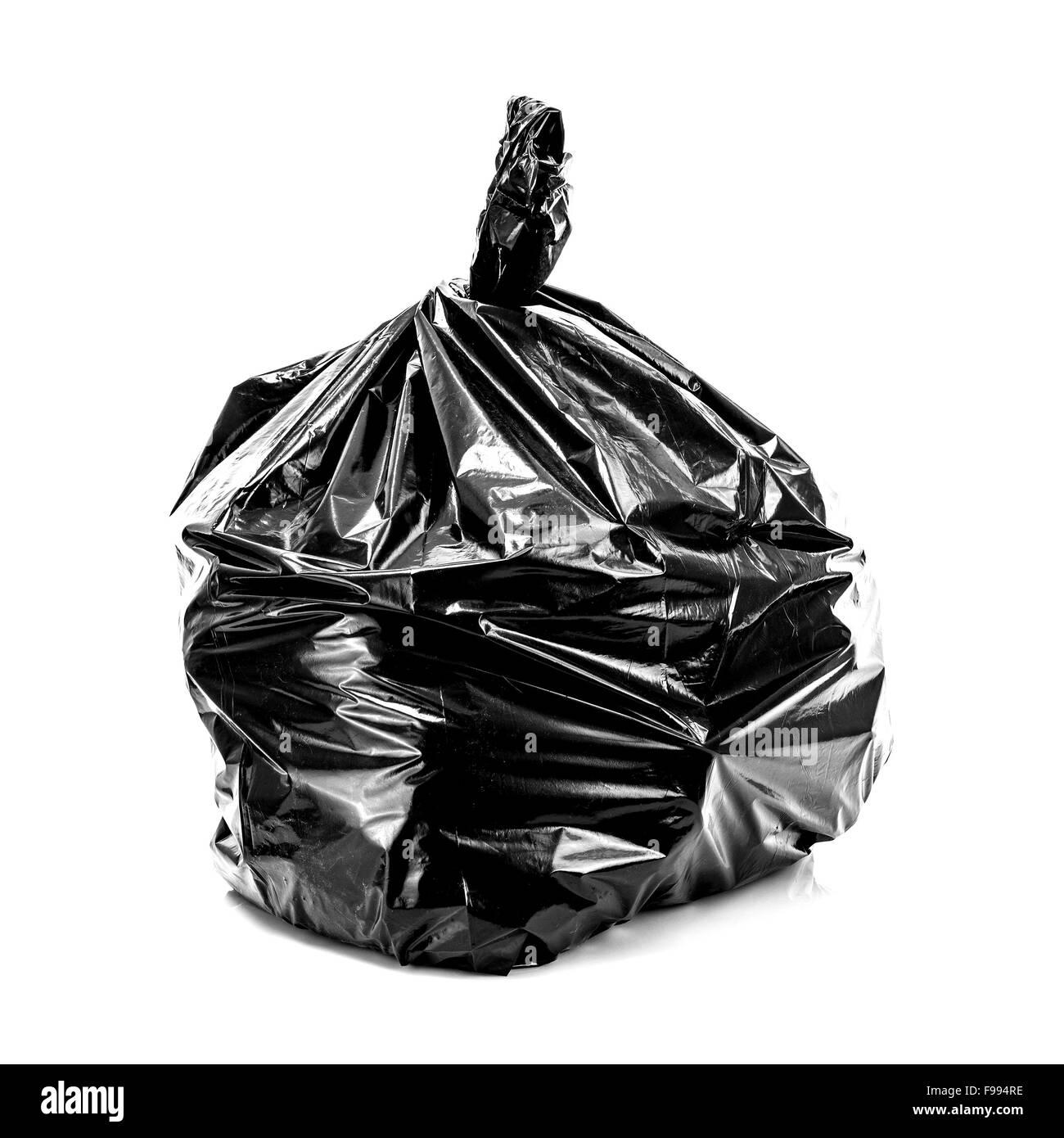 Black Rubbish Bag on white background - Stock Image