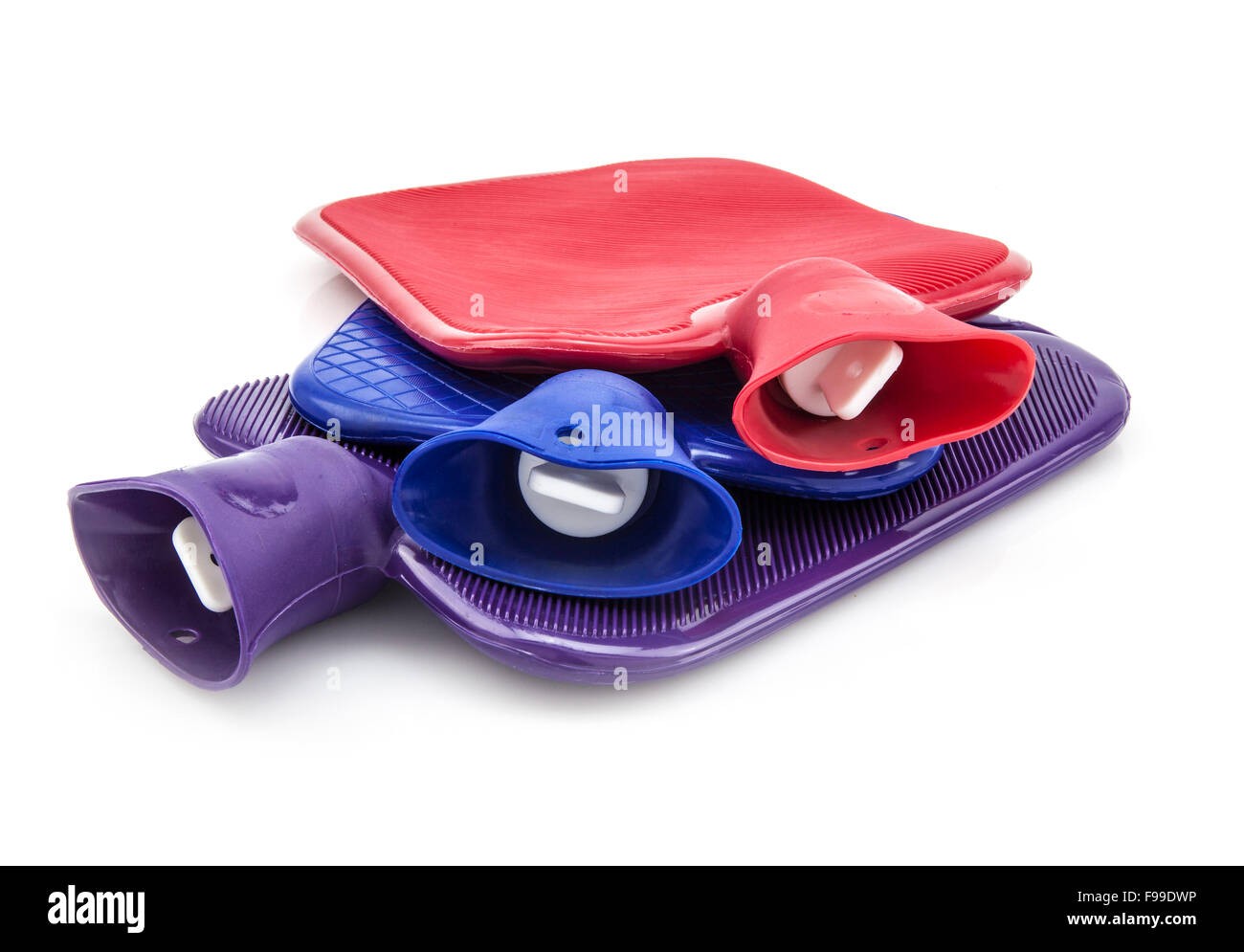 Three Hot Water Bottles on a White Background - Stock Image