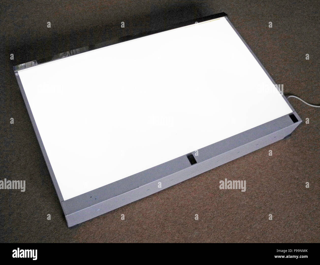 Lightbox viewing X-Rays transparencies graphic artwork - Stock Image
