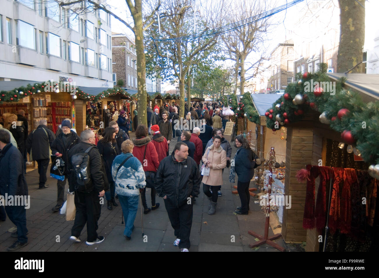 christmas fair fairs fayre fayres xmas shoppers shopping shopper highstreet uk york people busy high street streets - Stock Image