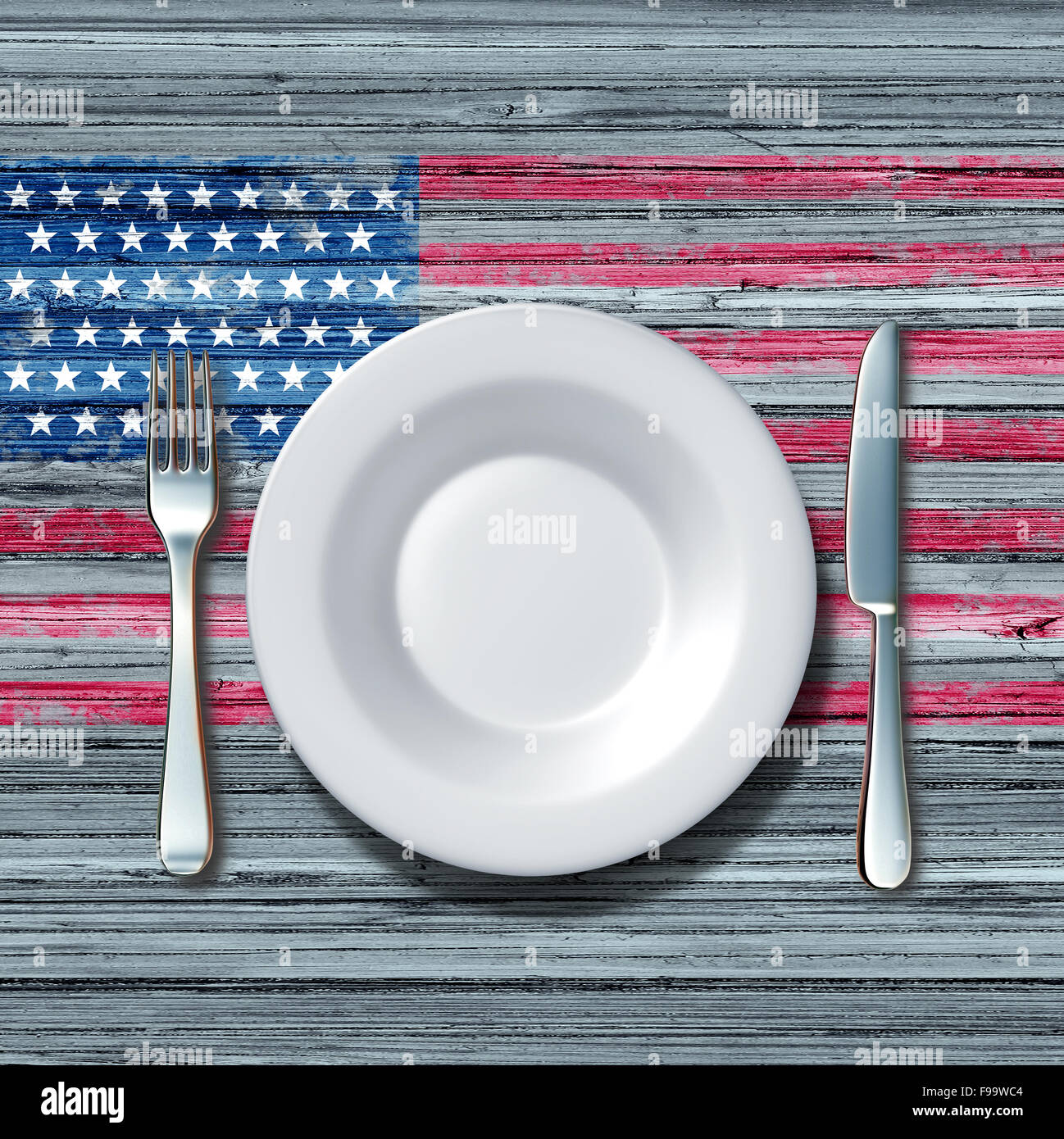 American cuisine food concept as a place setting with knife and fork on an old rustick wood table with a symbol - Stock Image