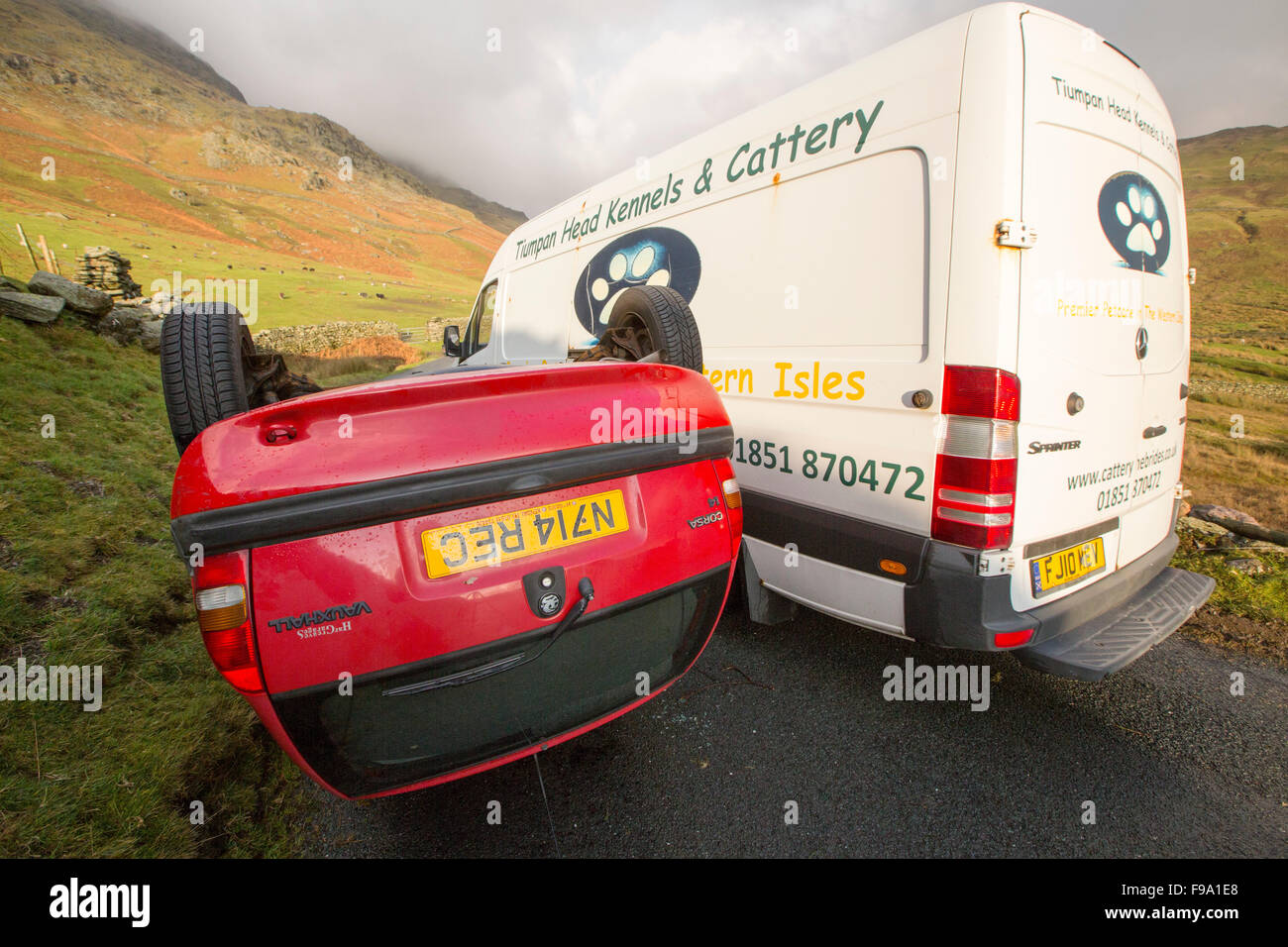 A car overturned on Kirkstone Pass above Ambleside in the Lake District, a victim of Storm Desmond, Cumbria, UK. - Stock Image