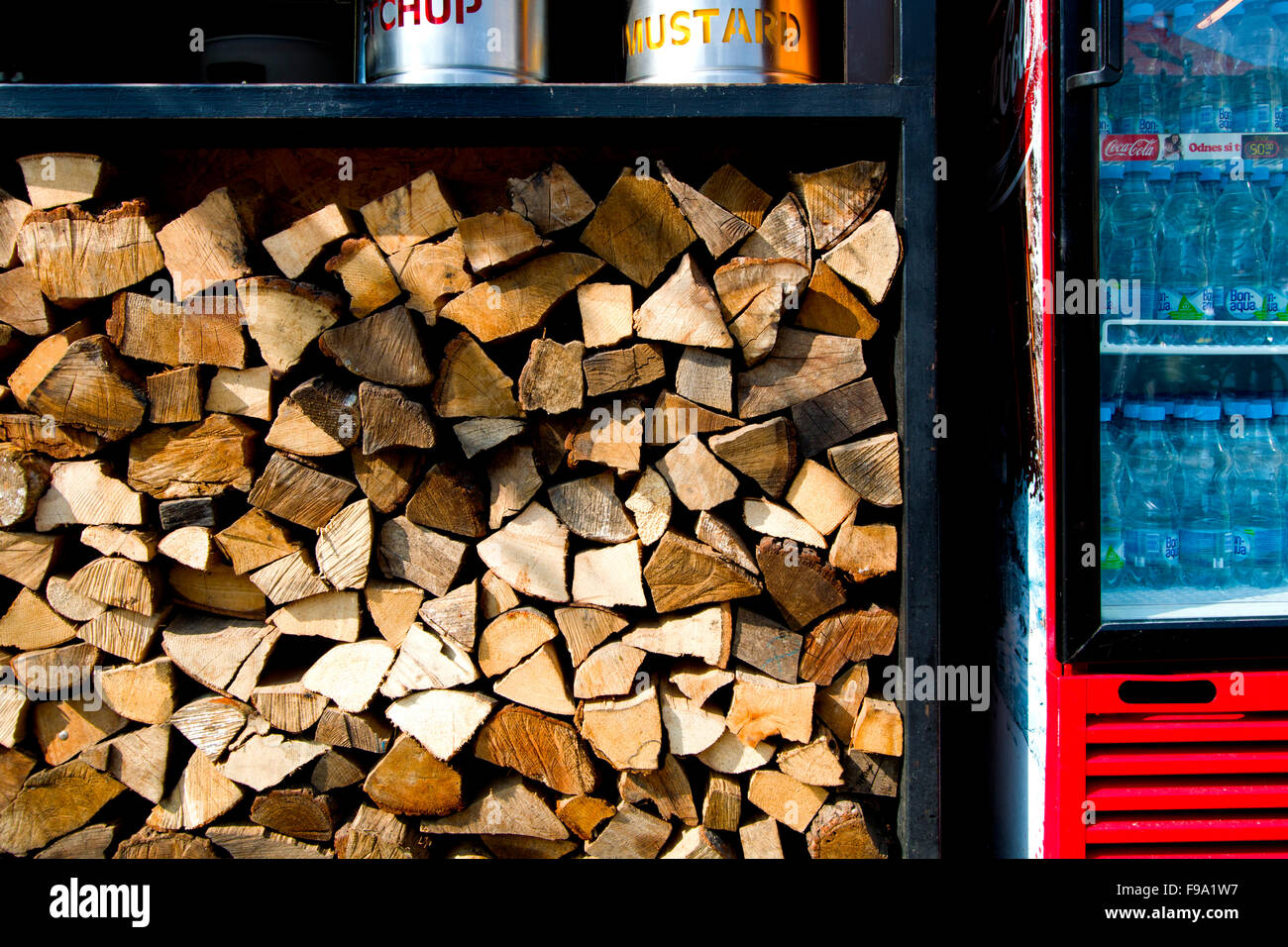 A stall on a market with fire wood - Stock Image