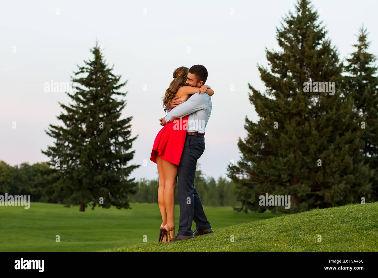 Guy and the girl tenderly embrace. - Stock Image