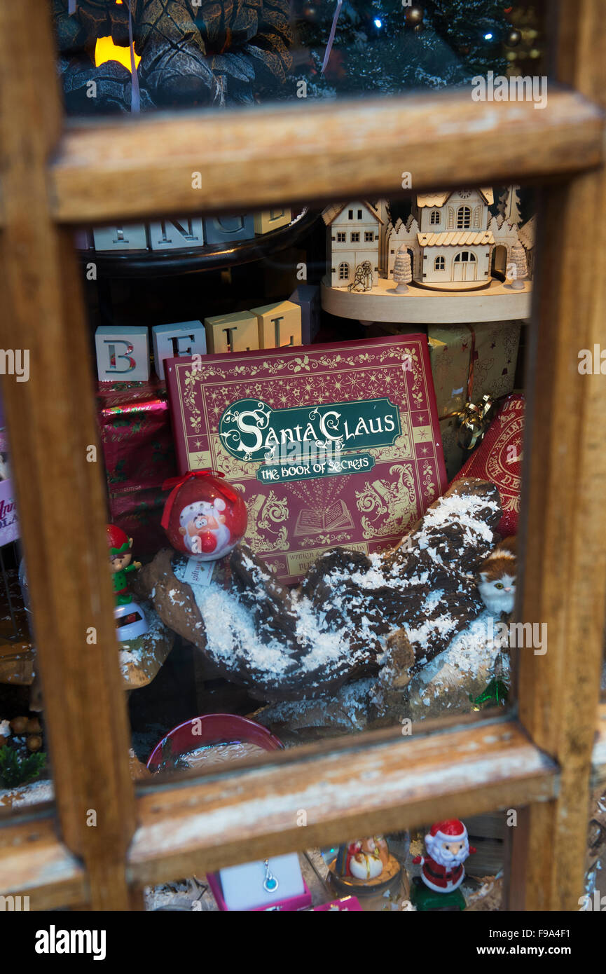 Santa Claus, The book of secrets in amongst a christmas shop display window at Bourton on the Water, Cotswolds, - Stock Image