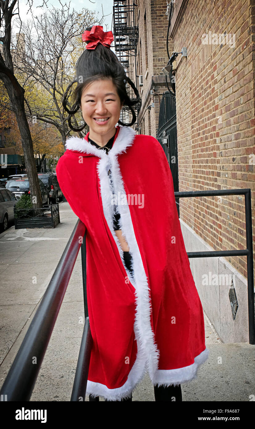A beautiful Asian woman in a Christmas outfits in Chelsea, New York ...