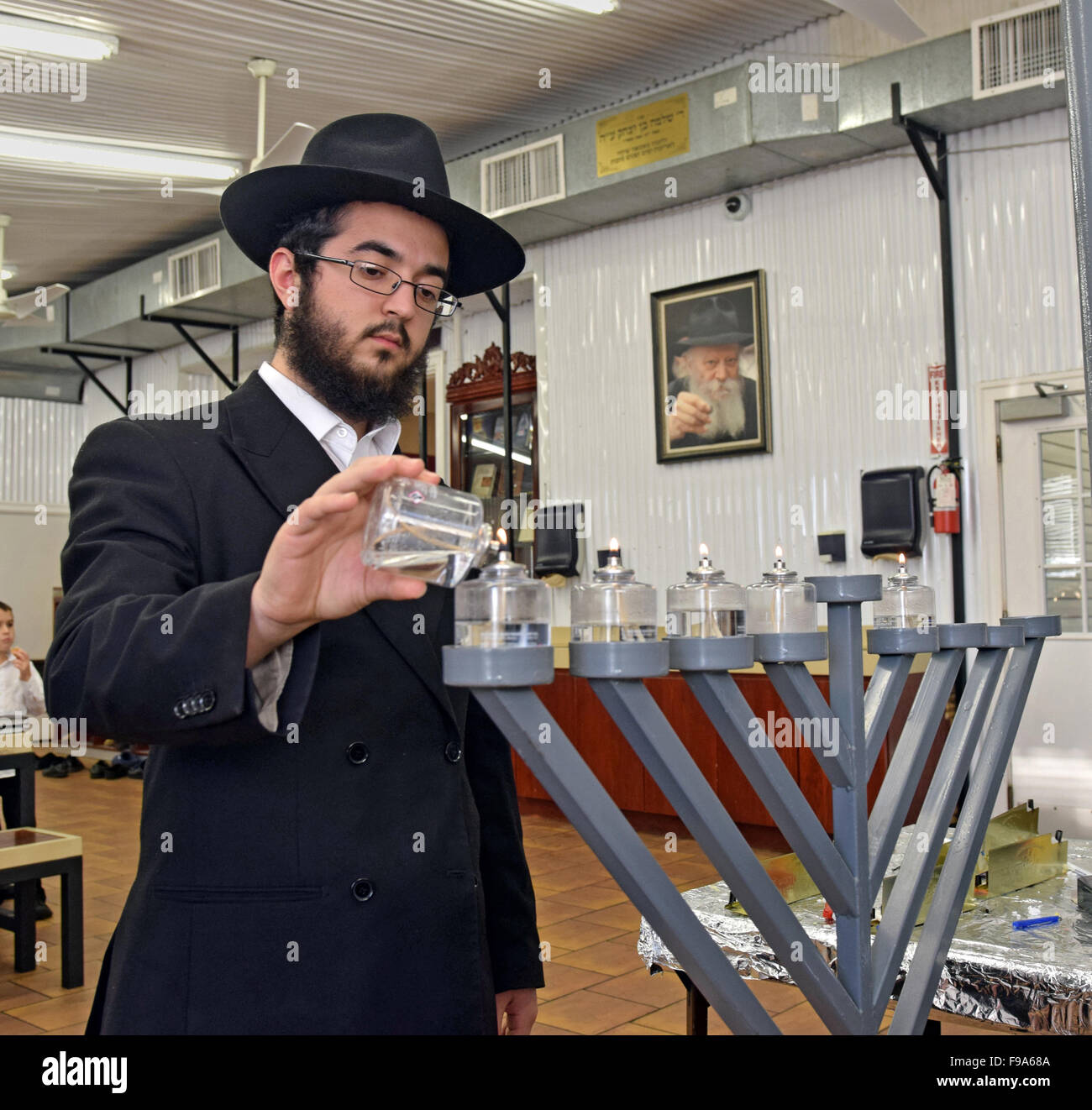 Chanukkah menorah lighting ceremony at the Ohel in Cambia Heights, Queens NYC near the graves of the last 2 Lubavitcher - Stock Image