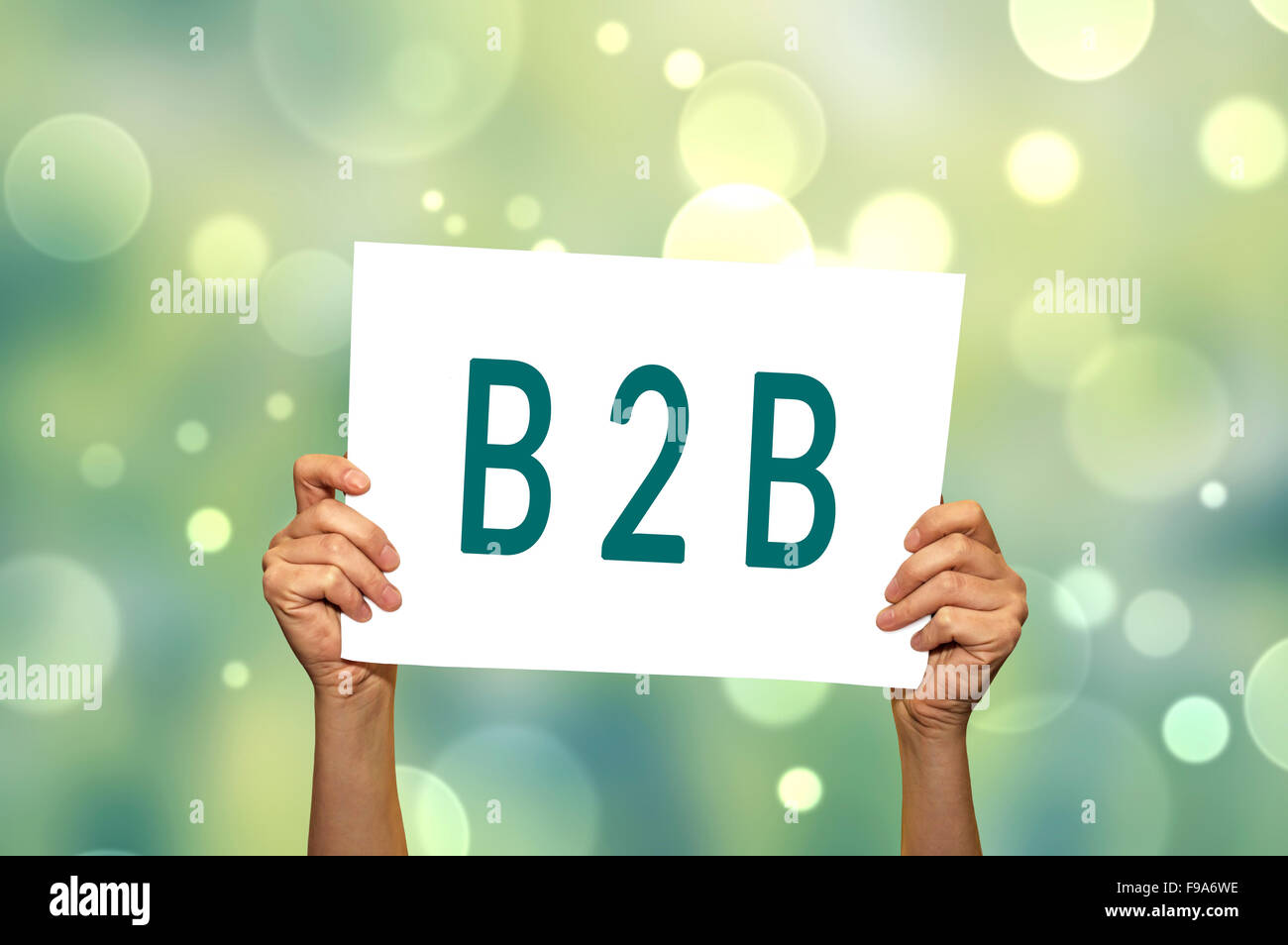 B2B (marketing) card in hand with abstract light background. Selective focus. Stock Photo