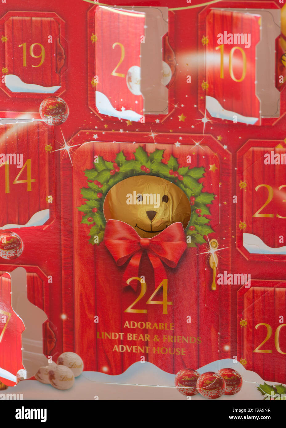 Partially opened Lindt chocolate teddy christmas advent calendar - Stock Image