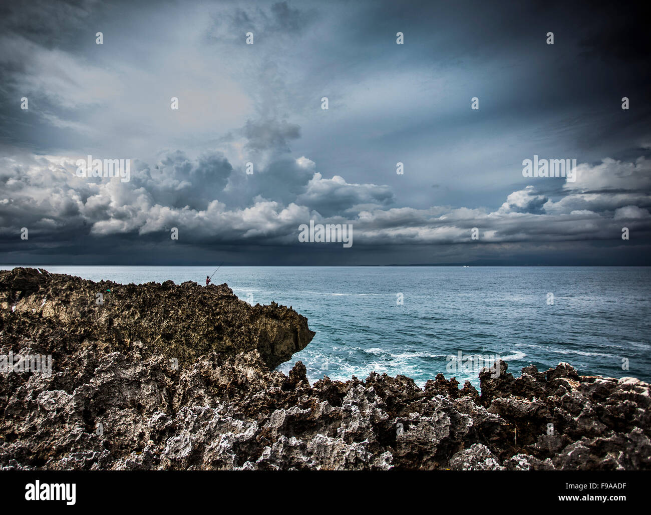 Fisherman and the Indian Ocean - Stock Image
