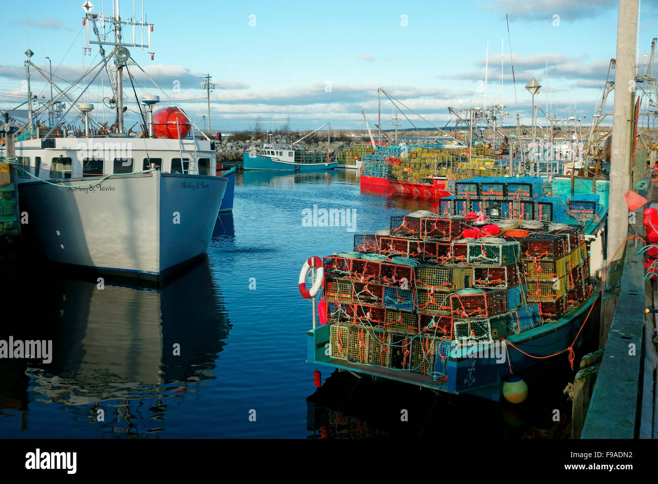 Lobster boats loaded with lobster traps just before the season opener or dumping day at Gunning Cove, Nova Scotia, - Stock Image
