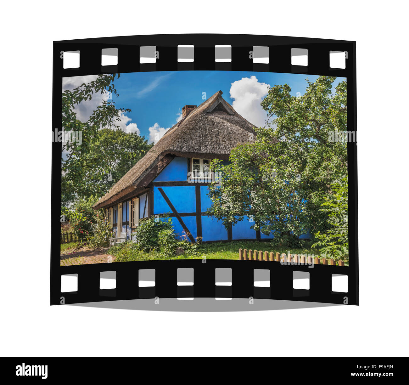 Blue half-timbered house with thatched roof in Warthe, Island of Usedom, Mecklenburg-Western Pomerania, Germany, - Stock Image