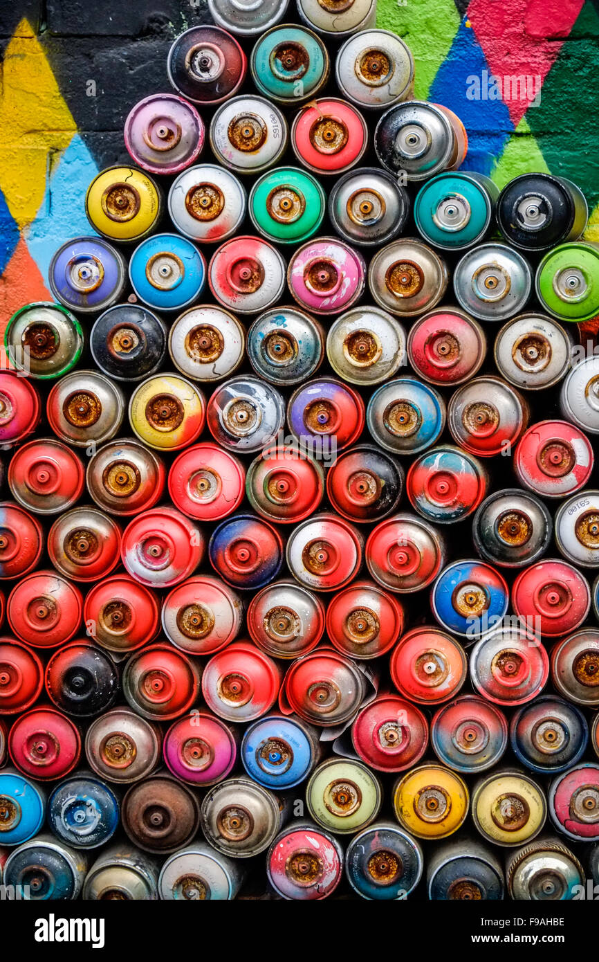 Close-up of spray paint tins grouped in an arty composition. - Stock Image