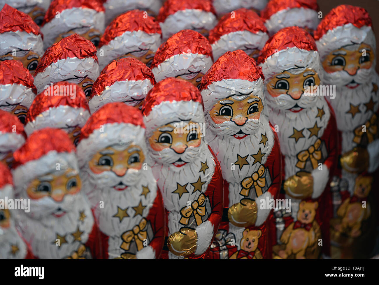 Kleinmachnow, Germany. 6th Dec, 2015. Small Santa Clauses made of chocolate stand in rows on display to be given - Stock Image