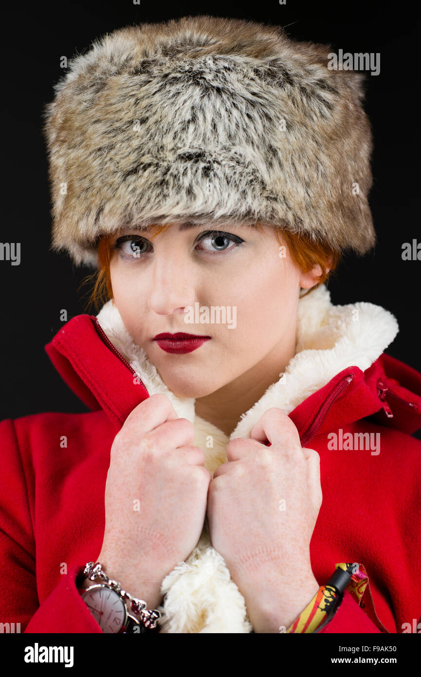 Winter fashion and clothing  A single solo young teenage woman girl with  flame red short hair by herself fb4476635e0
