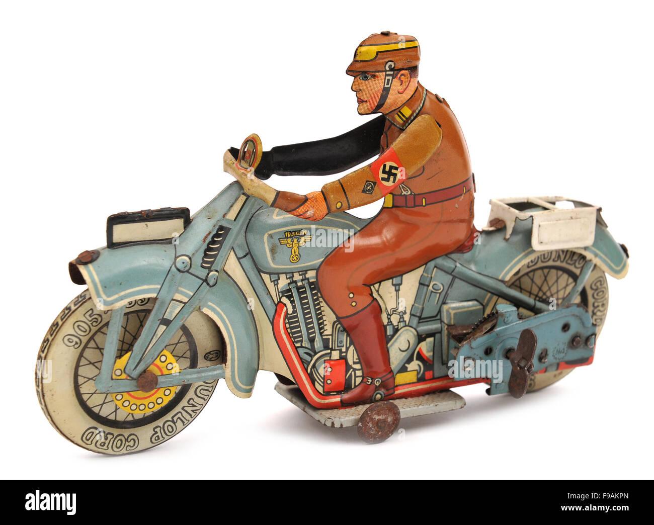 German tinplate clockwork motorcycle with Nazi rider children's toy - Stock Image