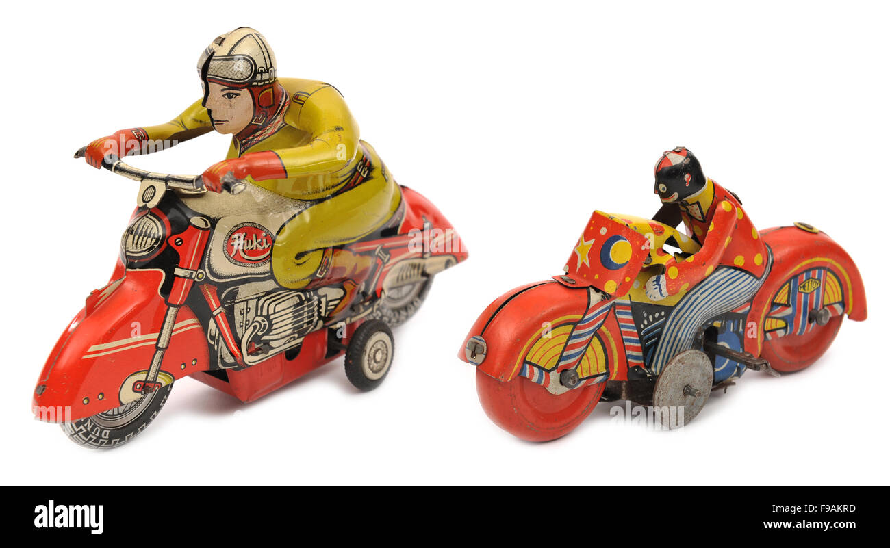 Huki and Mettoy clockwork tinplate motorcycles children's toys - Stock Image