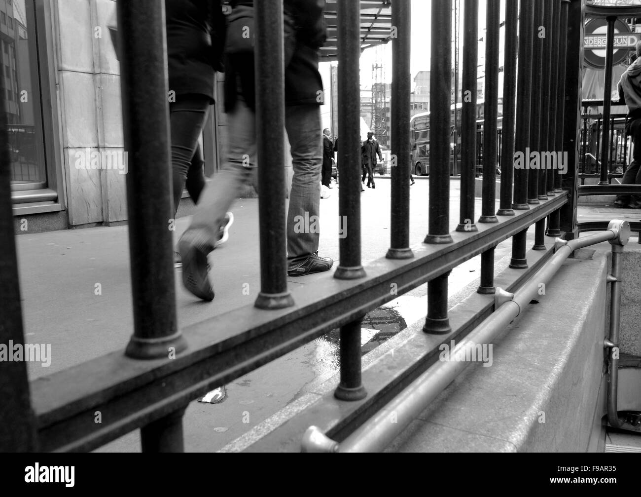 Street photography in London, people walk on the pavement near London Bridge, - Stock Image