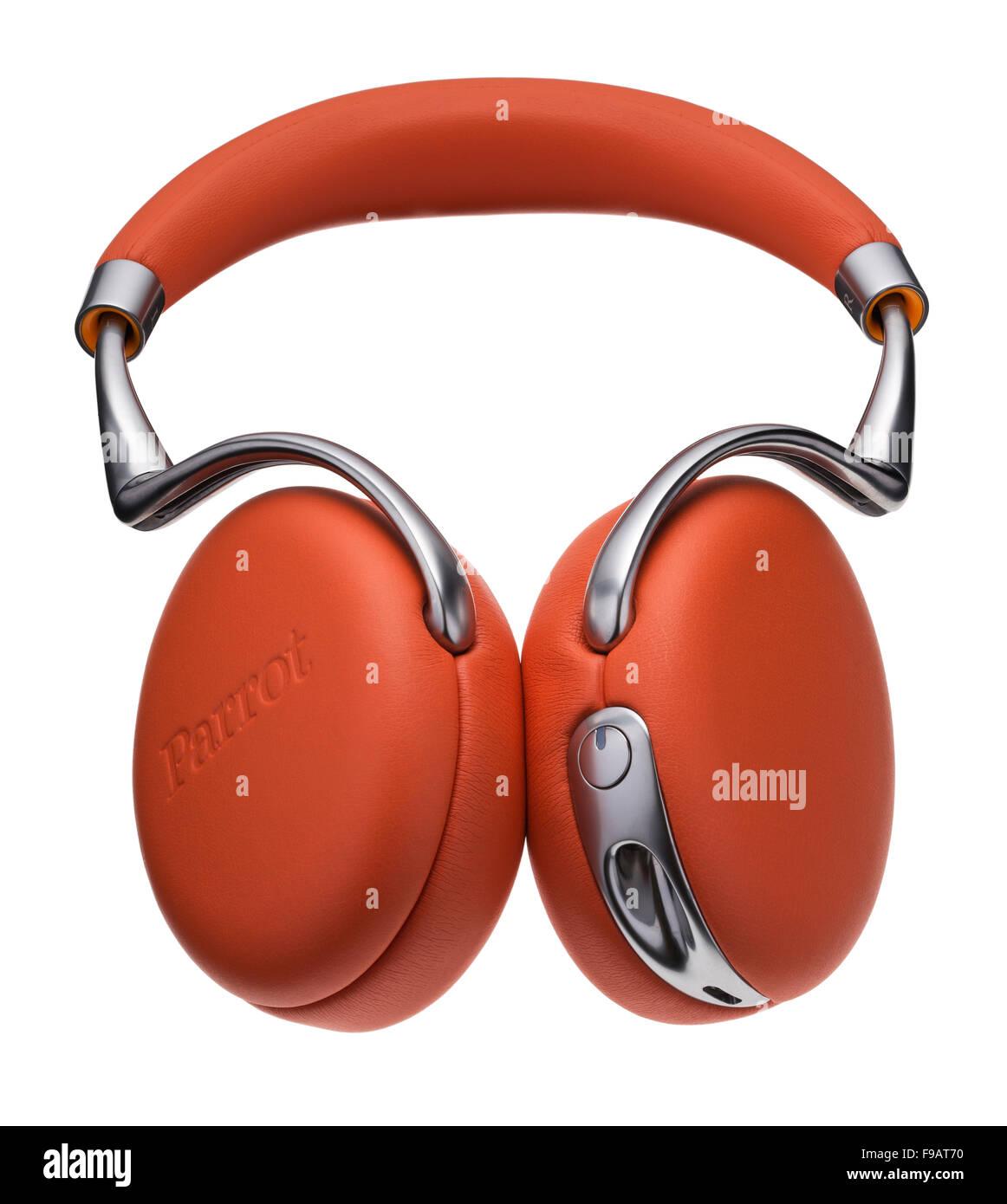 Parrot orange leather headphones. - Stock Image