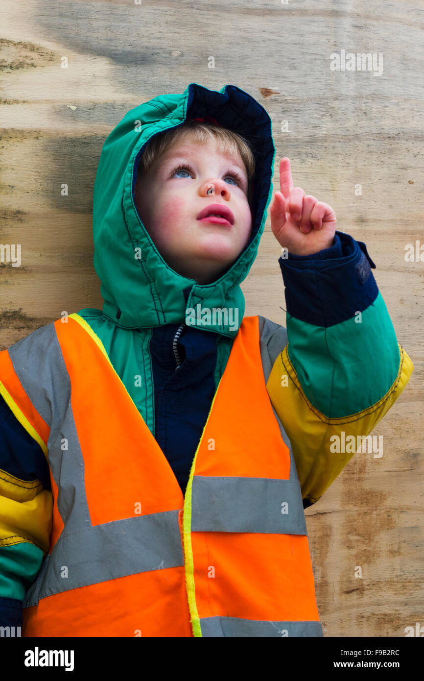 Young boy in high visibility vest - Stock Image