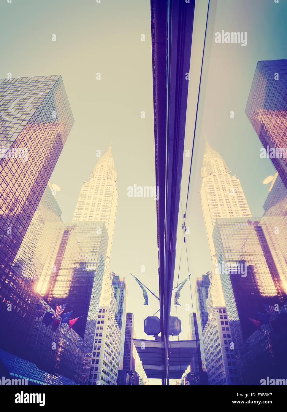 Vintage style Manhattan skyscrapers reflected in windows, NYC, USA. - Stock Image