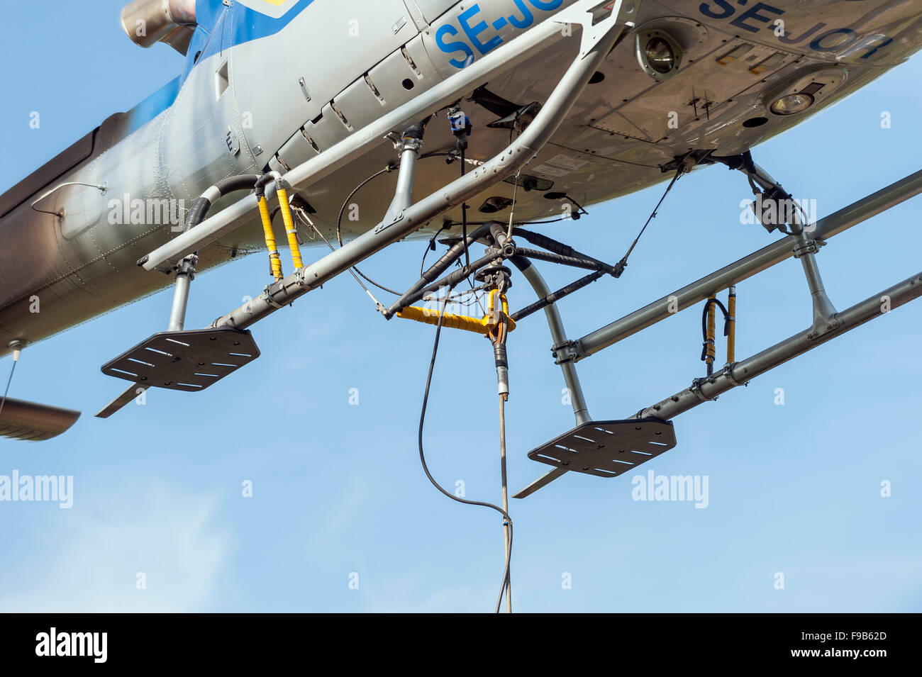 Load connection on helicopter - Stock Image