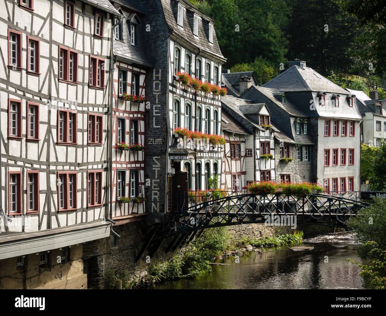 Old half-timbered houses above the river Rur in the town of Monschau / Eifel region / Germany. - Stock Image