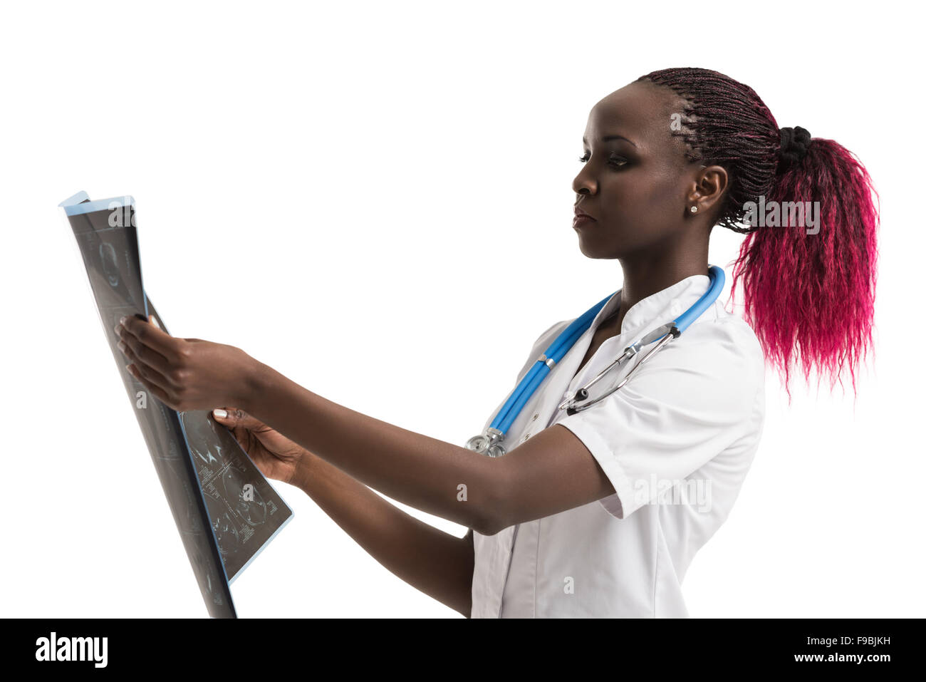 Closeup portrait of intellectual african woman healthcare doctor with white labcoat, looking at brain x-ray radiographic - Stock Image