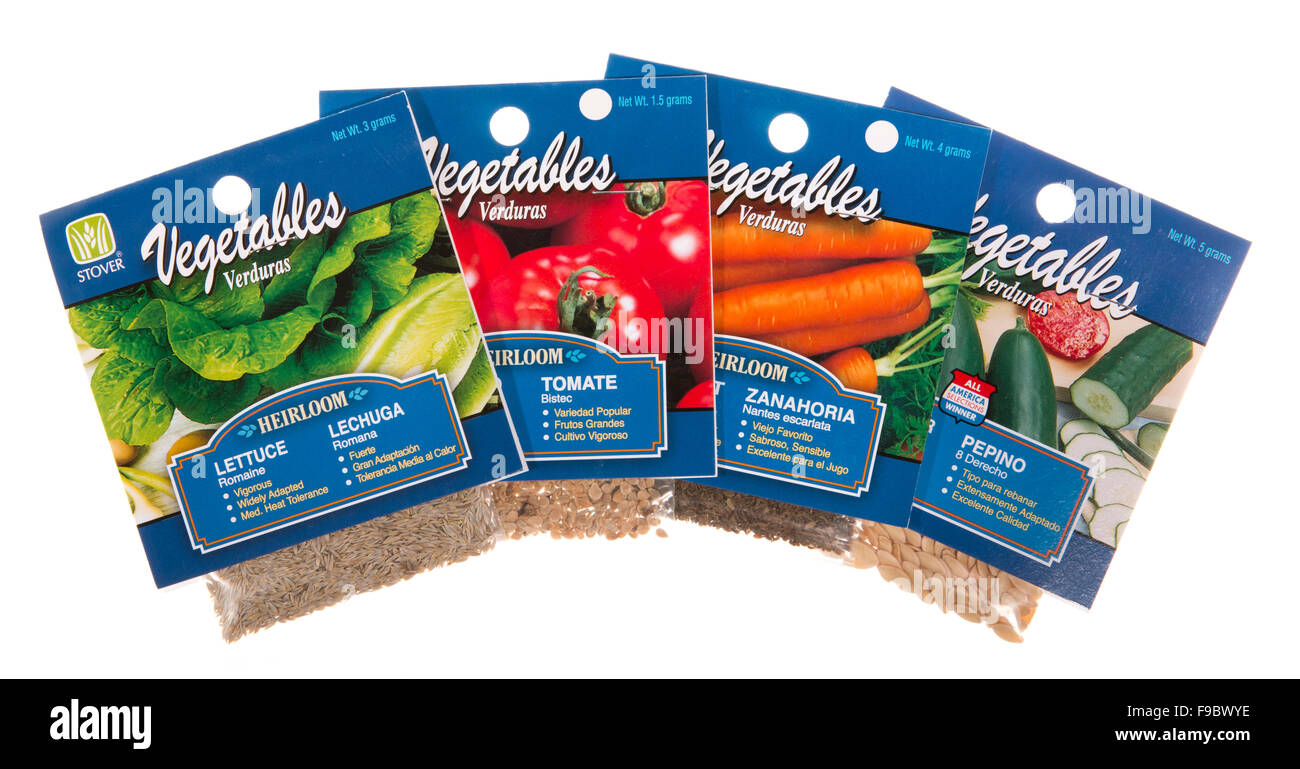 Vegetable garden seed packets with English and Spanish descriptions