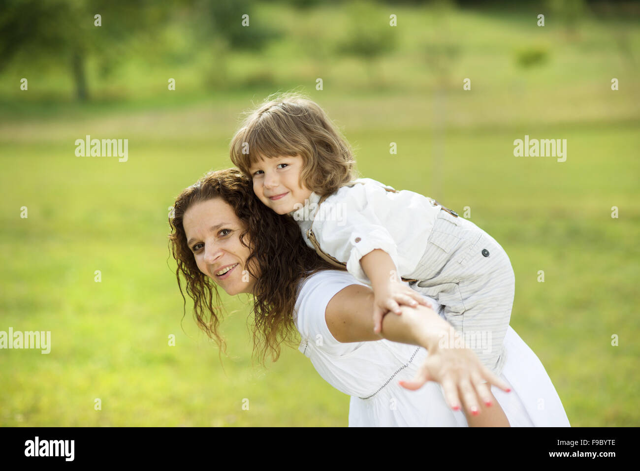 Mother and son playing funny games together - Stock Image