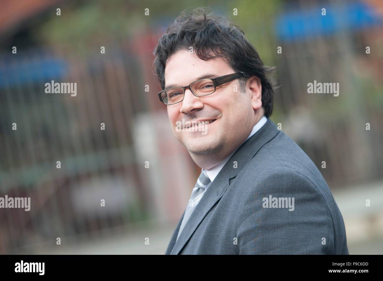Berlin, Germany. 9th Dec, 2015. The chairman of the Jewish Parish in Berlin, Gideon Joffe, smiles as he is pictured - Stock Image